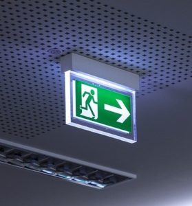 emergency exit sign lit up in dark