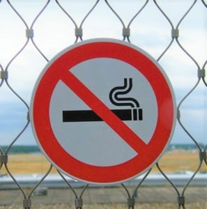 Smoking prohibited fire safety sign on fence