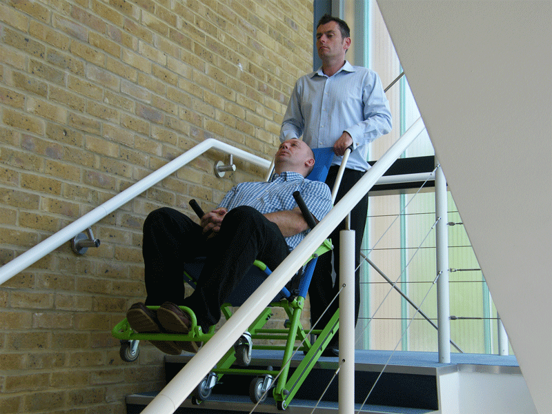 Demonstration of an evacuation chair in use